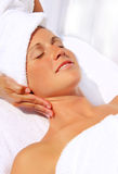 Pretty woman receiving massage Stock Image