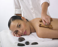 Pretty woman receiving massage. Portrait of a beautiful woman relaxing with a  massage at the day spa Stock Photo