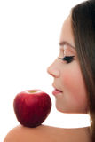 Pretty woman with red apple Royalty Free Stock Images