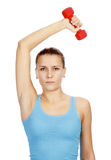 Pretty woman with red barbell Royalty Free Stock Image