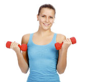 Pretty woman with red barbells. Posing against white background Stock Image
