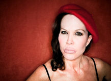 Pretty woman in a red beret Stock Photo
