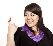 Pretty woman with red bow on finger Stock Photography