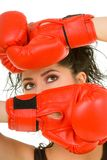 Pretty woman with red boxing glove Royalty Free Stock Photo
