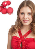 Pretty woman with red Christmas balls Stock Photography