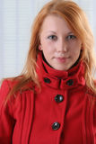 Pretty woman in red coat Royalty Free Stock Photography