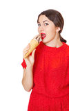 Pretty woman in red dress eating ice cream Royalty Free Stock Photo