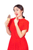 Pretty woman in red dress eating ice cream Stock Photos