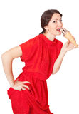 Pretty woman in red dress eating ice cream Stock Photography