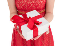 Pretty woman in red dress offering present Stock Photography