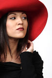 Pretty Woman in Red Hat. Pretty girl in elegant  red hat smiling Stock Image