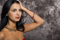 Pretty Woman in Red Looking at Right Frame Stock Images