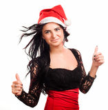 Pretty woman in red santa claus hat Stock Photography