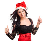 Pretty woman in red santa claus hat Stock Image