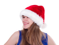 Pretty woman in red santa claus hat laughing Stock Image