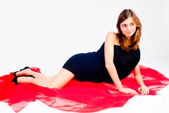 Pretty woman on red scarf Royalty Free Stock Images