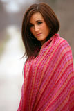 Pretty Woman in Red Shawl. Pretty young brunette woman in red shawl Stock Image