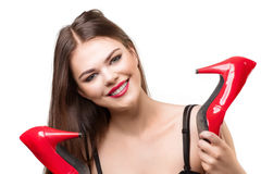 Pretty woman with red shoes Stock Image