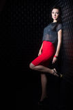 Pretty woman in red skirt Royalty Free Stock Image