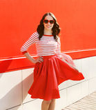 Pretty woman in red sunglasses and dress against the colorful Stock Photos