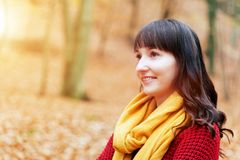 Pretty woman in red sweater smiling in fall autumn park Stock Photos
