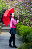 A pretty woman with red umbrella Stock Photography