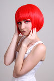 Pretty woman in red wig Stock Photos