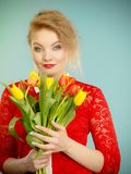 Pretty woman with red yellow tulips bunch Royalty Free Stock Images