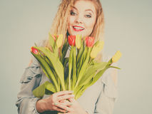 Pretty woman with red yellow tulips bunch Stock Photo