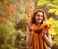 Pretty woman relaxing in the autumn park Royalty Free Stock Photos