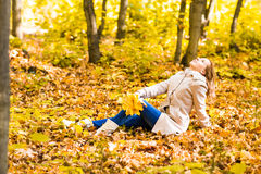 Pretty woman relaxing in the autumn park Stock Images