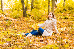 Pretty woman relaxing in the autumn park Royalty Free Stock Image