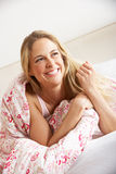 Pretty Woman Relaxing In Bed Royalty Free Stock Images