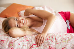 Pretty Woman Relaxing On Bed Stock Photo
