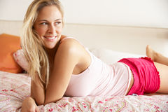 Pretty Woman Relaxing On Bed Royalty Free Stock Photography