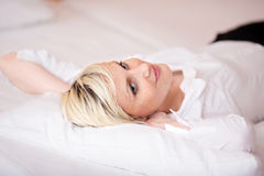 Pretty Woman Relaxing On Bed Stock Photos
