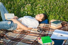 Pretty woman relaxing and falling asleep outside Royalty Free Stock Image