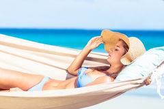Pretty woman relaxing in the hammock Stock Image