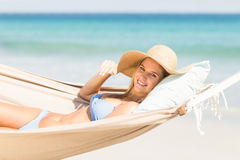 Pretty woman relaxing in the hammock Stock Photos