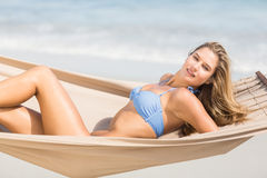 Pretty woman relaxing in the hammock and smiling at camera Royalty Free Stock Photography