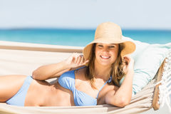 Pretty woman relaxing in the hammock and smiling at camera Royalty Free Stock Photos