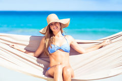 Pretty woman relaxing in the hammock and smiling at camera Stock Photo