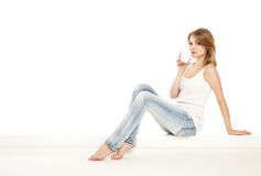Pretty woman relaxing at home and drink a coffee. Over white Stock Photo
