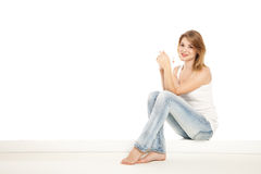 Pretty woman relaxing at home and drink a coffee. Over white Stock Images