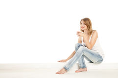 Pretty woman relaxing at home and drink a coffee. Over white Royalty Free Stock Photos