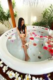 Pretty woman relaxing in jacuzzi Royalty Free Stock Photography