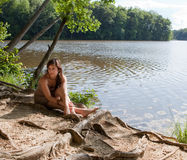 Pretty Woman Relaxing By Lake Royalty Free Stock Photography