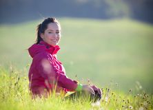 Pretty woman relaxing on a meadow Royalty Free Stock Photo