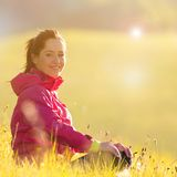 Pretty woman relaxing on a meadow Stock Photos
