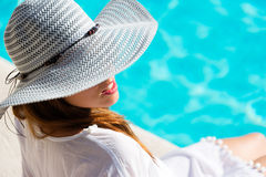 Pretty woman relaxing at poolside on summer vacation Stock Photography